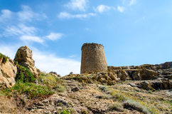 Stone tower in Corsica. Near the lighthouse Stock Photos