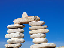 Stone tower in front of blue sky. Stones piled into a portal in front of blue sky Royalty Free Stock Photography