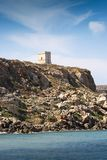 Ancient stone tower on a hill. Near the sea Stock Images
