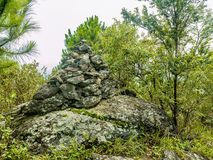 Stone tower or `Khao Chedi ` in Thai name on Khao Luang mountain in Ramkhamhaeng National Park. Sukhothai province Thailand stock images