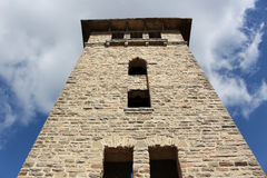Stone tower looking up. Old stone tower with clouds and sky Royalty Free Stock Image