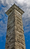 Stone Tower. Tower made from sandstones pointing to blue sky Royalty Free Stock Images