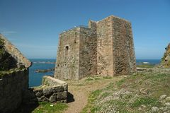 Fortifications on Ile aux Moines in Brittany. Stone tower on one of the sept-iles. France's oldest and largest bird sanctuary found on the Seven Islands stock images