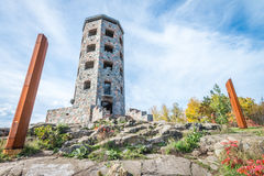 Stone tower in park. Public stone viewing tower during a sunny day Stock Photos