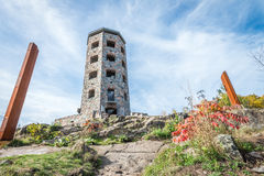 Stone tower in park. Public stone viewing tower during a sunny day Stock Photo