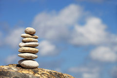 Stone tower on a pebble beach Royalty Free Stock Images