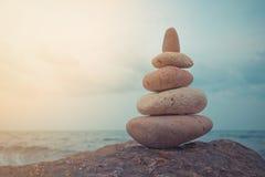 Stone tower on a pebble beach. Stock Photos
