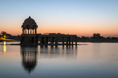 Stone tower in sacred Gadi Sagar lake in Jaisalmer Stock Photos