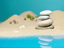 Stone tower in sea shore miniature background Royalty Free Stock Photo
