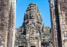 Stone tower with stone face in the doorway in Angkor Wat Royalty Free Stock Images