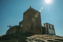 Stone tower with sunlight at the medieval Belmonte Castle. Stone walls and square tower over rocky hill with sunlight at the medieval Belmonte Castle. A small royalty free stock photography