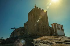 Stone tower with sunlight at the medieval Belmonte Castle. Stone walls and square tower over rocky hill with sunlight at the medieval Belmonte Castle. A small royalty free stock images