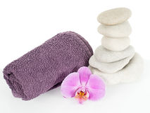 Stone tower with towel and orchid flower Stock Photos