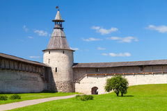 Stone tower and walls with wooden roofs of old fortress Royalty Free Stock Photo