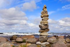 Stone tower. A stone tower at waters edge stock photography