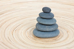 Stone tower on a wooden board Royalty Free Stock Photography