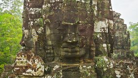 Stone towers of the old temple with a faces. 12th - 13th century. Cambodia, Angkor, Bayon stock video