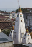 Stone town rooftops and Hindu shrine.  stock images