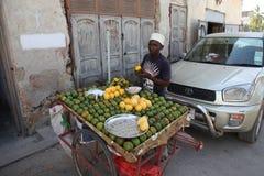 Stone town of Zanzibar, a man selling fruit royalty free stock photo
