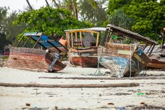 Boats resting on the beach awaiting repairs. royalty free stock images