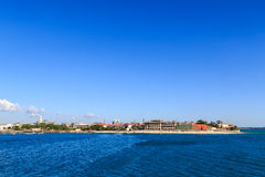 Stone town Zanzibar seen from the water. On a sunny day royalty free stock images