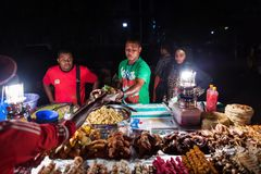 Stone Town, Zanzibar - Tanzania on September 10, 2015: Local people selling foot in night on local market. Zanzibar is an island. Part of Tanzania stock photography