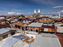 Stone Town in Zanzibar. Wide angle view of the architecture and typical roofs in Stone Town, the capital of Zanzibar island, Tanzania, East Africa with towers of stock image