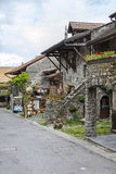 Stone townhouses by the street in Yvoire Royalty Free Stock Photo