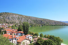 Stone traditional houses and lake Orestiada in Kastoria Royalty Free Stock Image