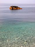 Stone in transparent clear wat. Yellow brown stone in transparent clear sea water Stock Photos