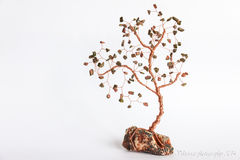Stone tree. Trees stones with copper wire Stock Photos