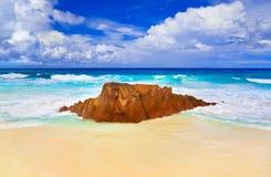 Stone on tropical beach Stock Photo