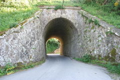 Stone Tunnel. A stone tunnel under a railway Stock Photo