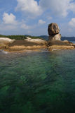 Stone in turquoise sea. Thailand rock coast of Andaman turquoise sea Royalty Free Stock Photo