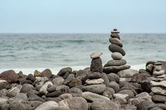 Stone turrets on the coast by the sea stock image