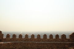 Stone turrets and smokey sky, Golconda Fort Stock Photo