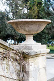 Stone vase on the railing of the old staircase Royalty Free Stock Photography