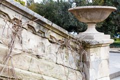 Stone vase on the railing of the old staircase Stock Photos