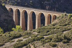 Stone viaduct in Albentosa, Teruel. Spain. Green way. Architecture Stock Photography
