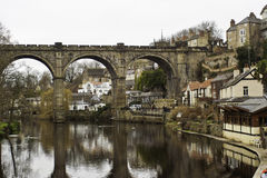 Stone viaduct at Knaresborough. Historical stone viaduct bridge with arches reflected in the still water of the river at Knaresborough, England Royalty Free Stock Photos