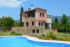 Stone Villa with garden and pool Royalty Free Stock Photography
