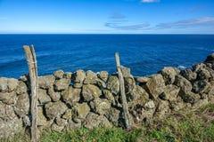 Stone volcanic wall near ocean Royalty Free Stock Photo