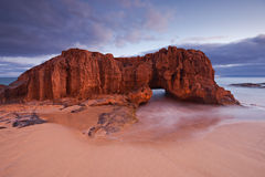 Stone Vulture. Big rock with hole at the beach of Calheta in Porto Santo Island, Madeira, Portugal Stock Photos