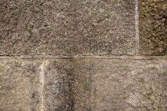 Stone wal. Large stone wall texture background. dark grey rough cut royalty free stock images