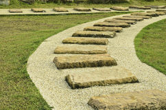 Stone walk paths in the park with green grass Royalty Free Stock Photos