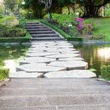 Stone walkway across water Royalty Free Stock Photography