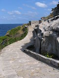 Stone walkway along coast Royalty Free Stock Image