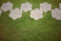 Stone walkway flower shape in garden with copyspace Royalty Free Stock Photo