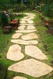 Stone walkway in garden Royalty Free Stock Photo