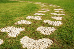 Stone walkway on a grassy in the park Royalty Free Stock Photos